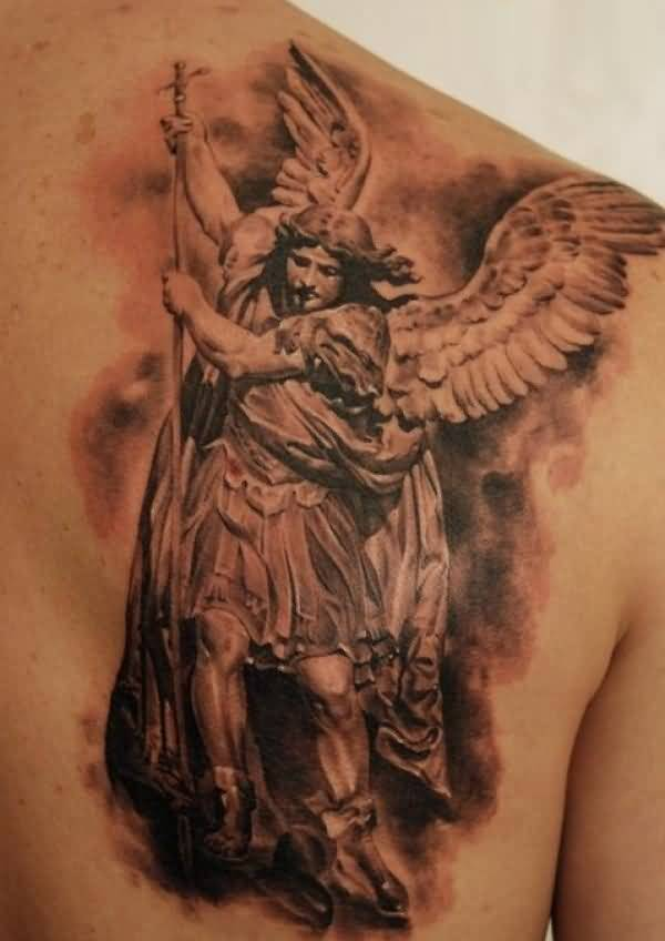 fantastic red light and black color ink angel warrior tattoo on boy's chest for boys only made by expert