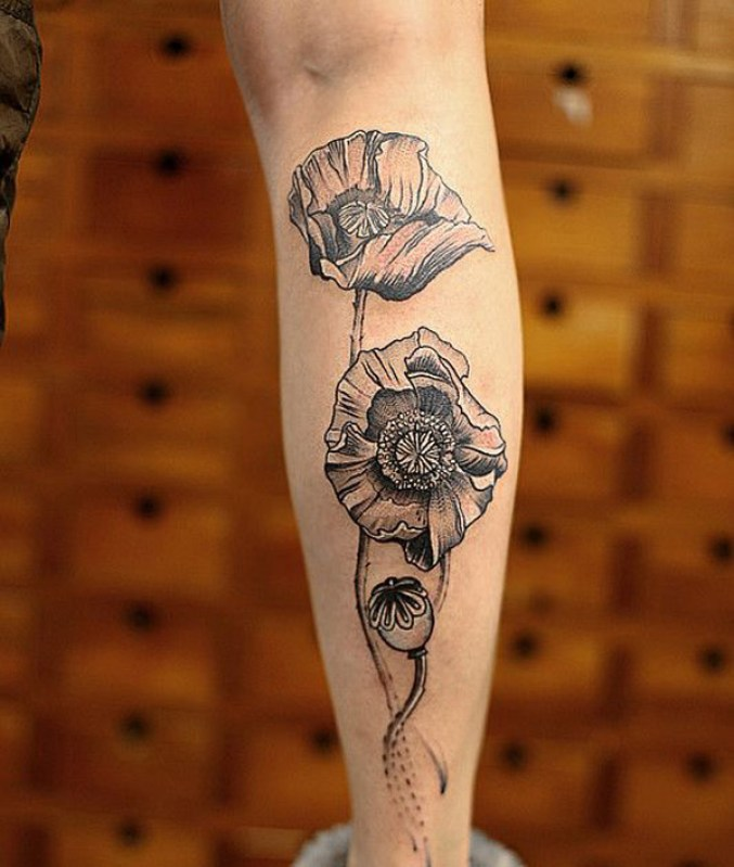 gorgeous Poppies tattoo on wrist With colourful ink For Man And Woman
