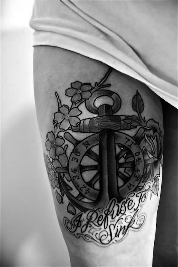great black color ink anchor tattoo on the thigh of girl made by expert