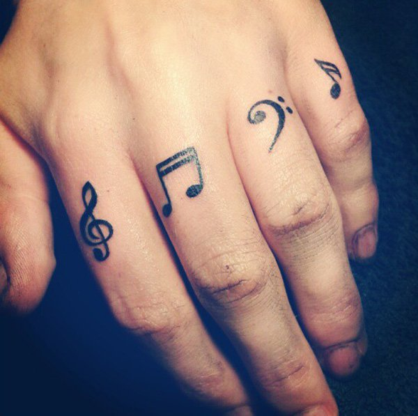 Great Music Finger Tattoo With Black Ink For Man And Woman
