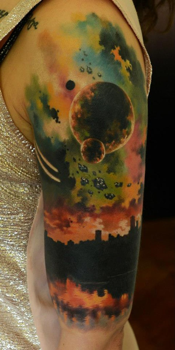 Incredible Colorful Space Tattoo On Arm With Colorful Ink For Man Woman