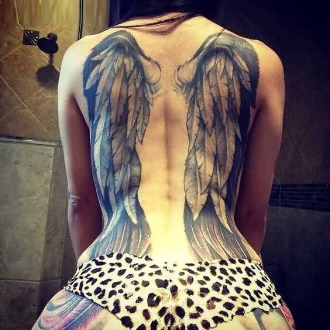 innovative black and gray color ink angel wings on girl's full back side for female made by expert artist