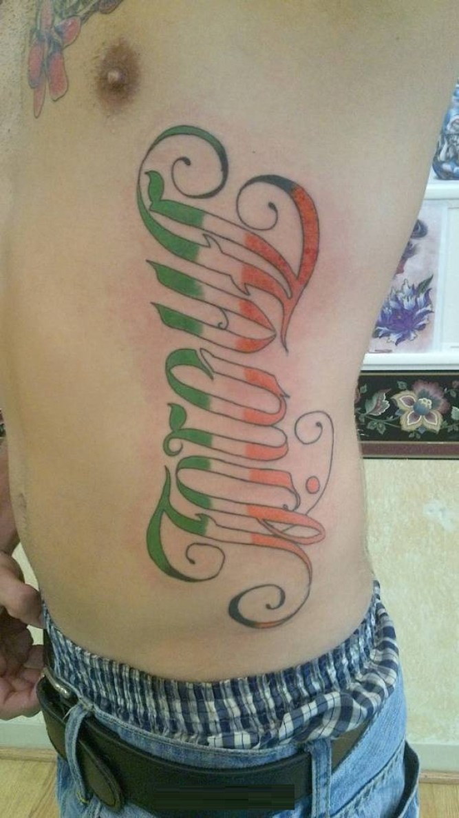 inspirational red and green color ink ambigram tattoo on rib side for boys