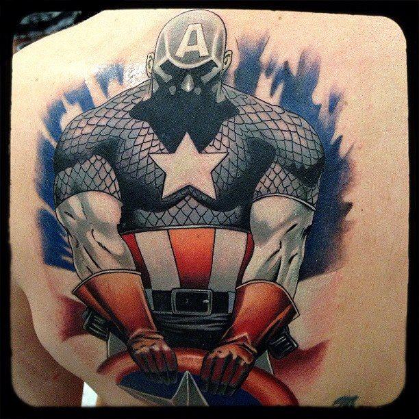 inspirational red white and blue color ink large 3d captain america shield tattoo on boy's back