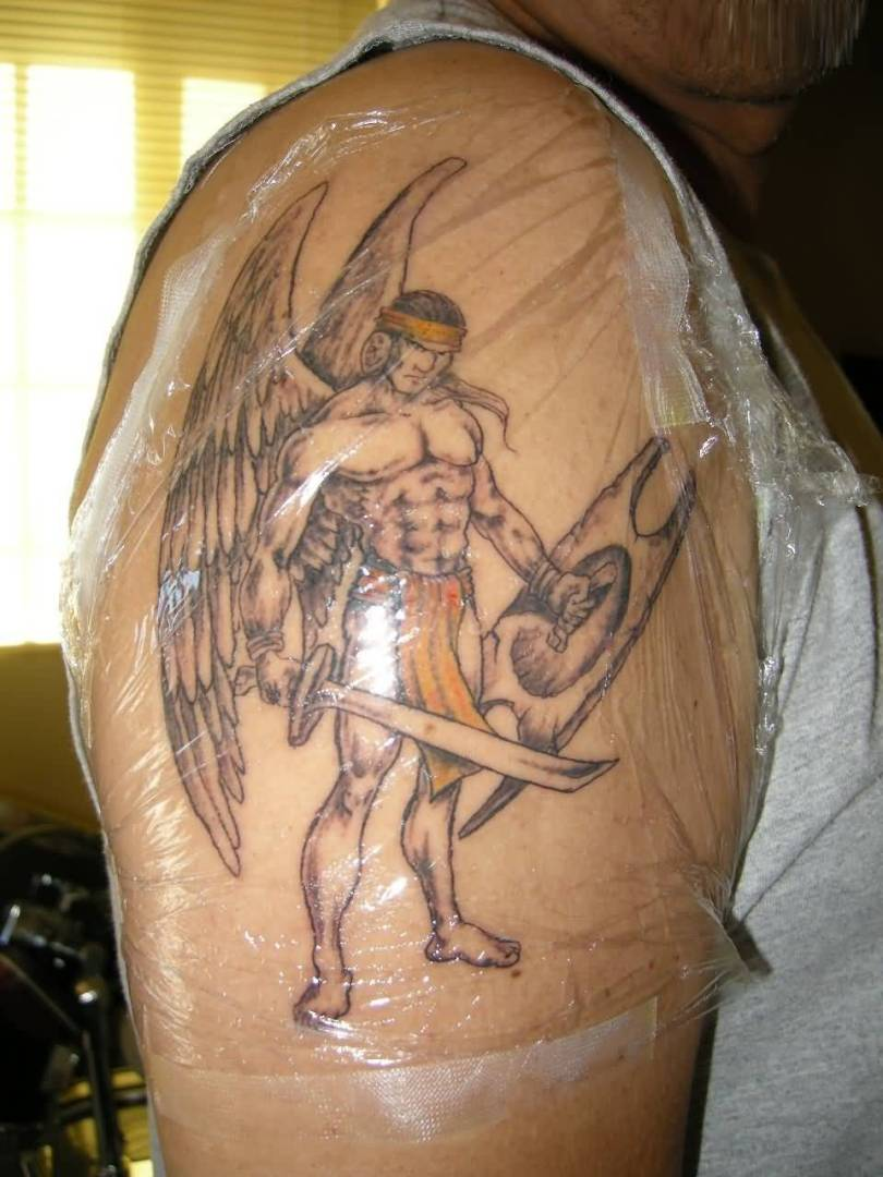 inspiring gray and yellow color ink angel warrior tattoo on boy's shoulder for boys only made by expert artist