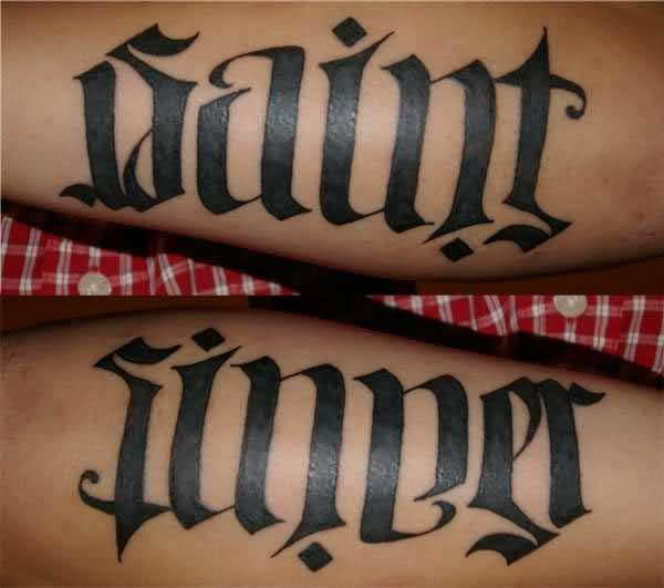 latest black color ink ambigram tattoo for boys on arm