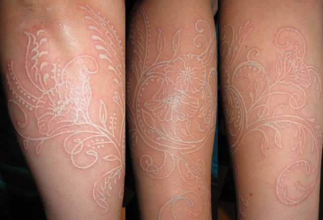 lovely white ink tattoo on leg white ink For Man And Woman