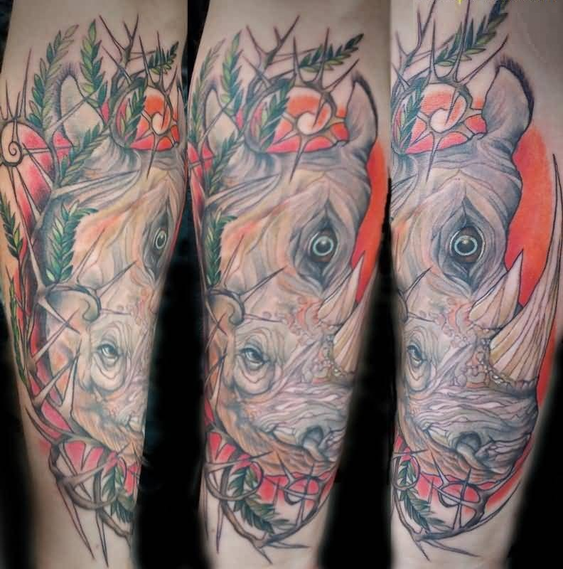 Marvelous Red And Yellow Collaboration Of African Rhino Tattoo On Boy Body