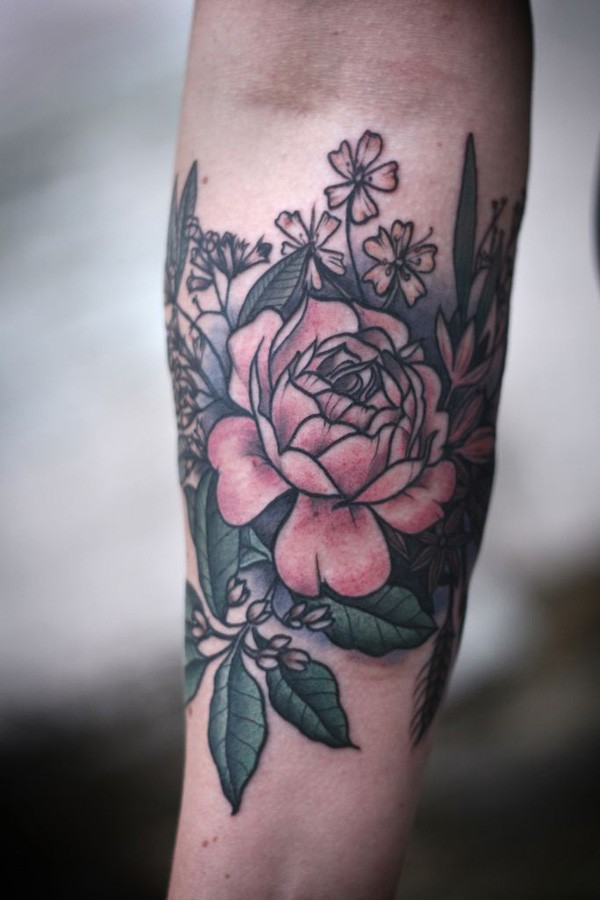 most amazing Peony tattoo on wrist With colourful ink For Man And Woman