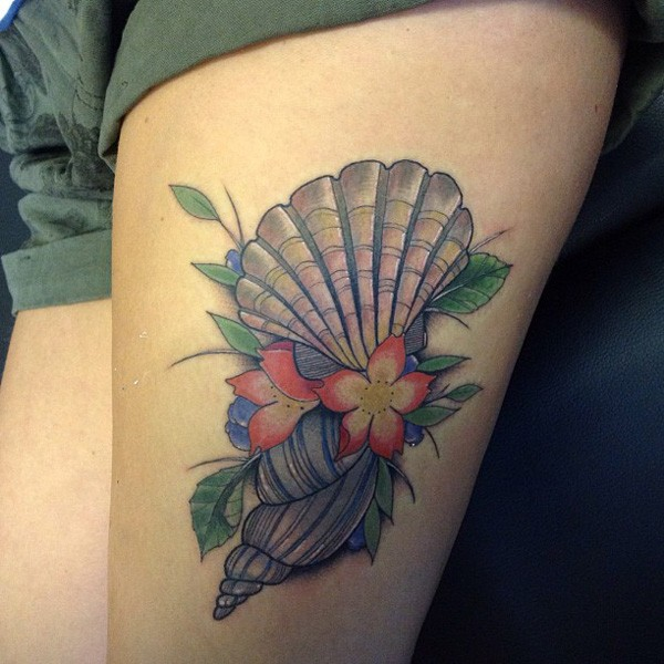 most amazing shell tattoo on thigh With colourful ink For Man And Woman