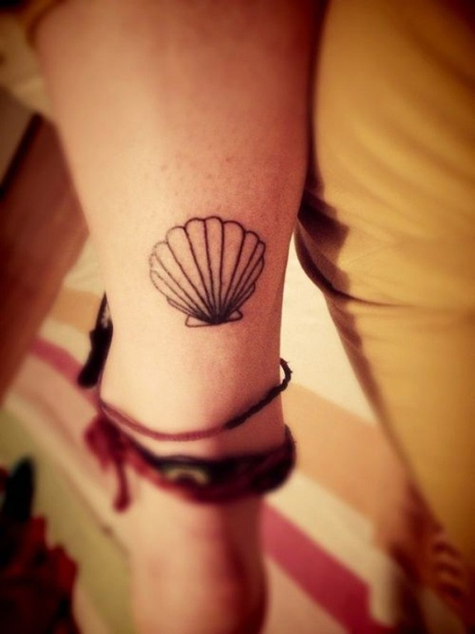 most amazing shell tattoo on wrist With Black ink For Man And Woman