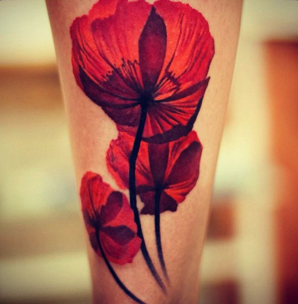 most inspirational Poppies tattoo on leg With colourful ink For Man And Woman