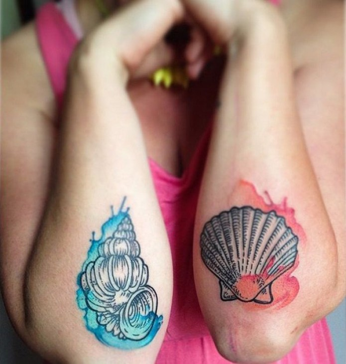 most shell tattoo on elbow With Black & colourful ink For Man And Woman