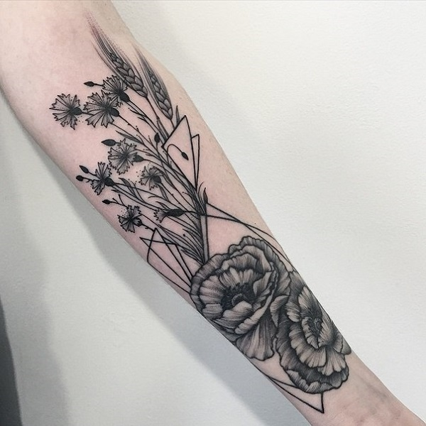 most simple flower with plants sleeve tattoo on arm With black ink For Man And Woma