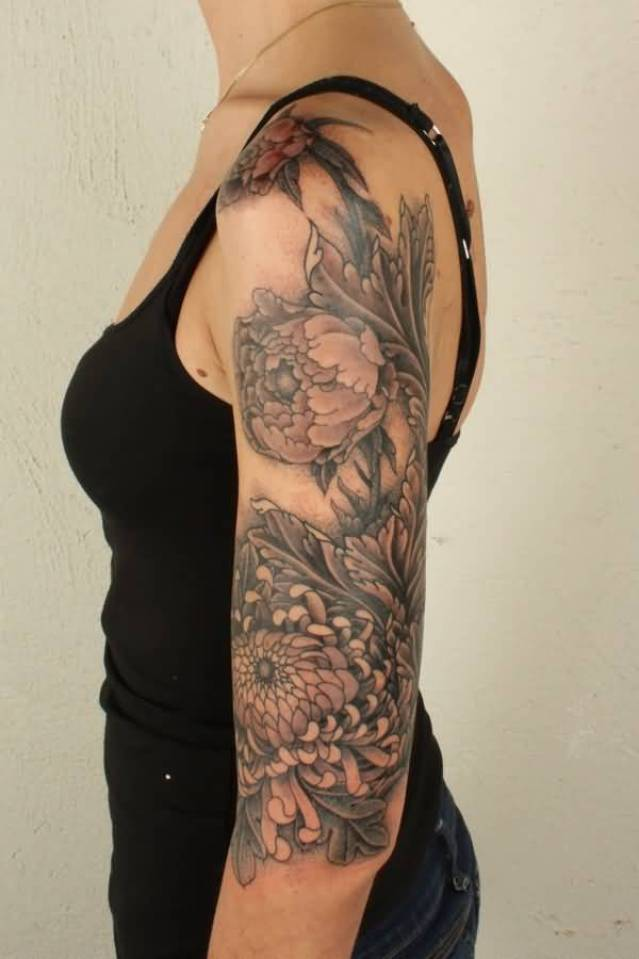 most trending chrysanthemum sleeve tattoo for women on arm with colourful ink for man & woman