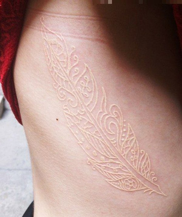 most wonderful White Ink Feather Tattoo on side With white ink For Man And Woman