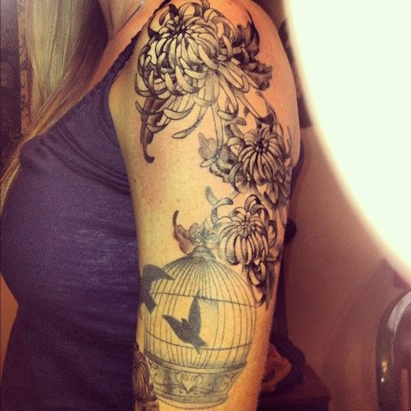 most wonderful chrysanthemum and bird tattoo on arm With black ink For Man And Woma
