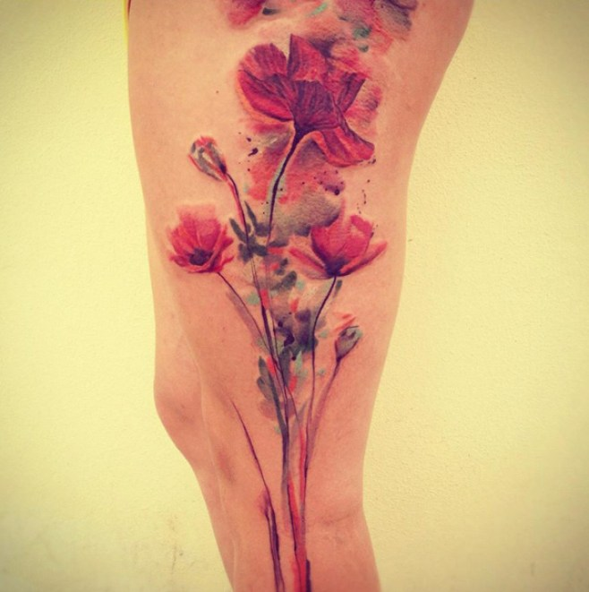 nice Watercolor Poppies Tattoo on Leg With colourful ink For Man And Woman