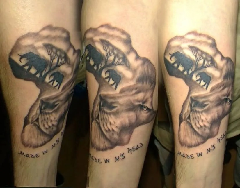 Passionate Gray Ink Africa Map And Lion Elephant Tattoo On Arm