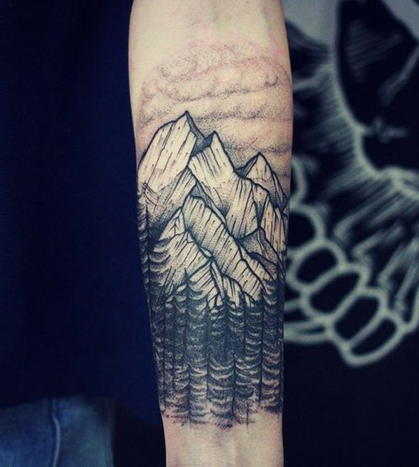phenomenal forest and mountain tattoo on wrist With Black ink For Man And Woman