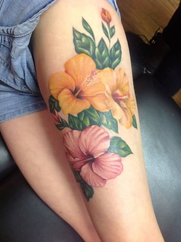 simple Hibiscus tattoo on thigh With colourful ink For Man And Woman