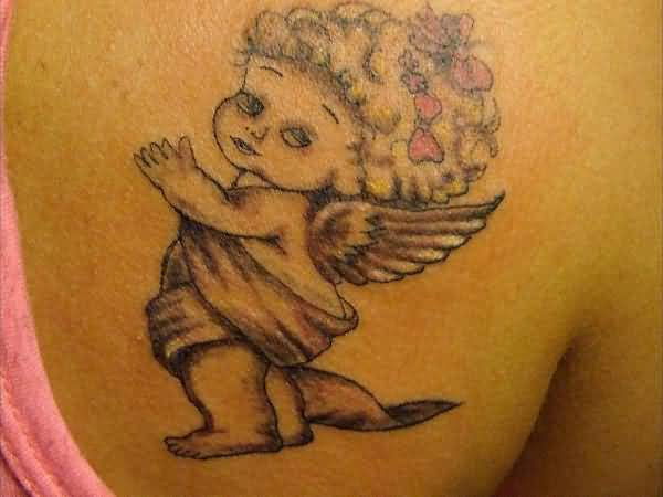 sweet golden color ink baby angel tattoo on girl shoulder for girls made by expert