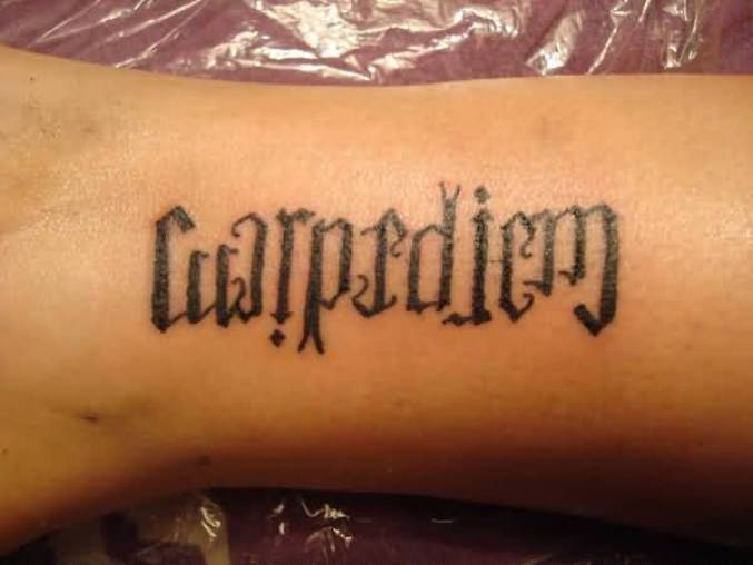 sweet gray color ink tattoo made in ambigram style for boys