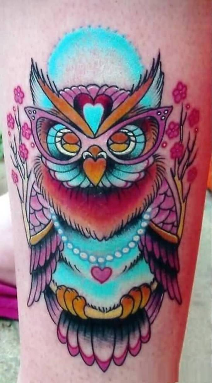 terrific red blue and yellow color ink animated owl tattoo on girl's sleeve for girls only made by expert artist