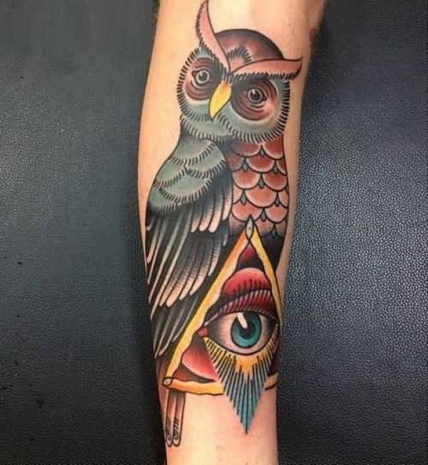 traditional red and black color ink animated owl tattoo on girl's sleeve for girls only made by expert