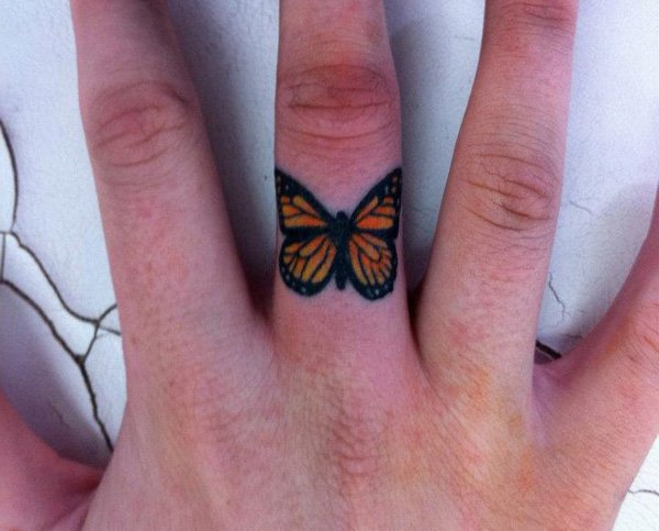 Unique Butterfly Finger Tattoo With Black &Amp; Brown Ink For Man And Woman