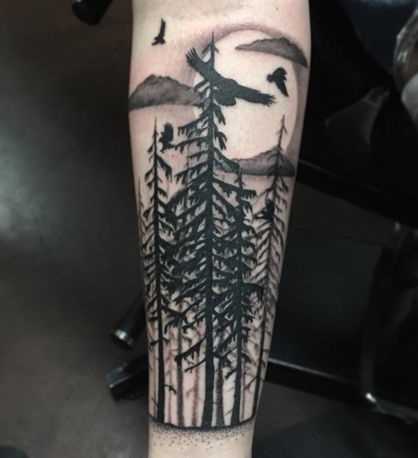 wonderful forest with birds sleee tattoo on wrist With Black ink For Man And Woman