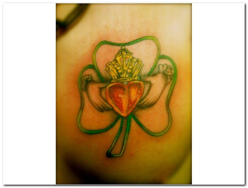 Adorable Green Yellow Red And Black Color Ink Irish Claddagh Tattoo Image For Girls
