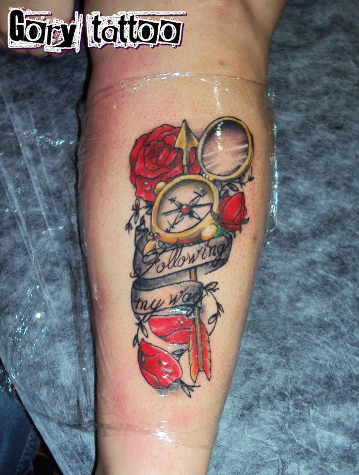 Attractive Red Blue And Black Color Ink Compass & Rose Tattoo On Arm For Girls