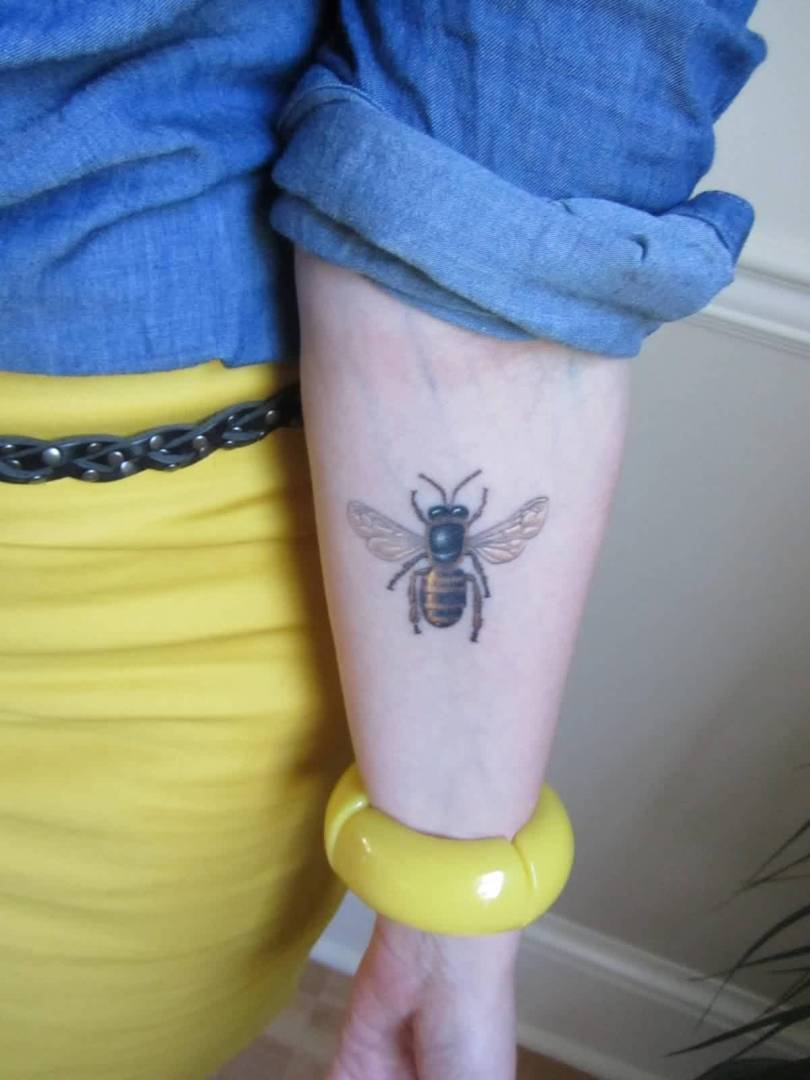 Awesome Black And Yellow Color Ink Bee Tattoo On Forearm For Girls