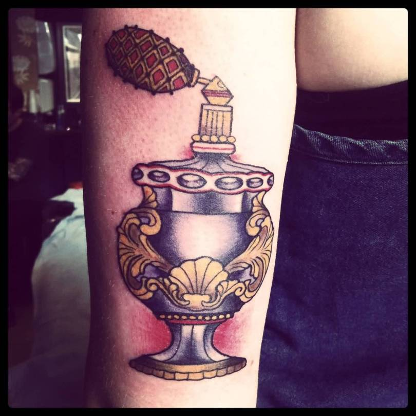Awesome Black Yellow And Red Color Ink Old Style Perfume Bottle Tattoo On Leg For Girls