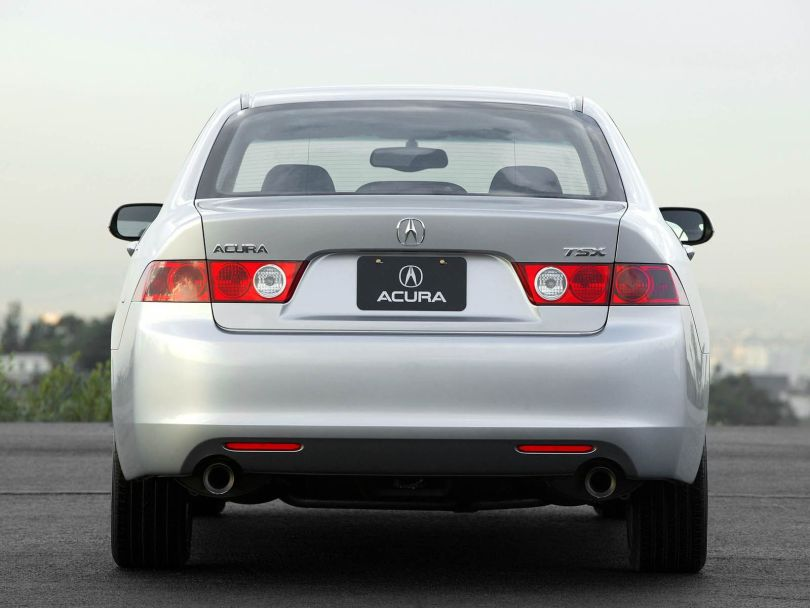 Back side view of silver color Acura TSX car