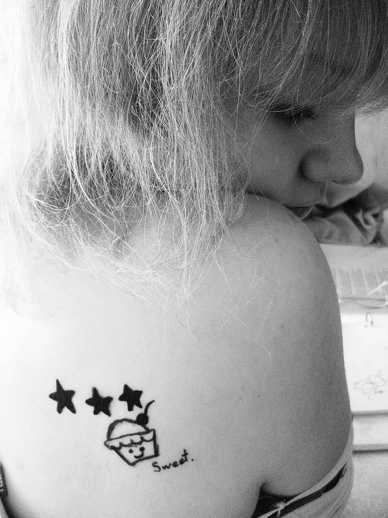 Beautiful Black And White Color Ink Cup Cake With Stars Tattoo Design On Shoulder For Girls