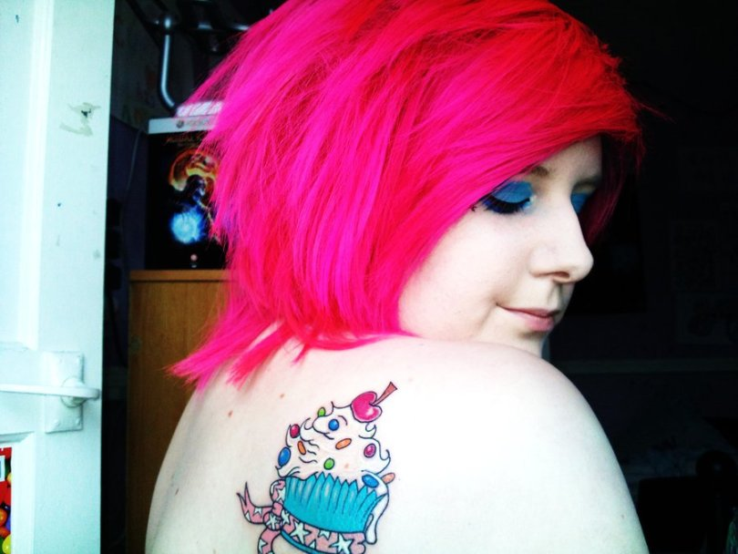 Brilliant Blue White Black And Red Color Ink Cup Cake Tattoo On Back Shoulder For Girls