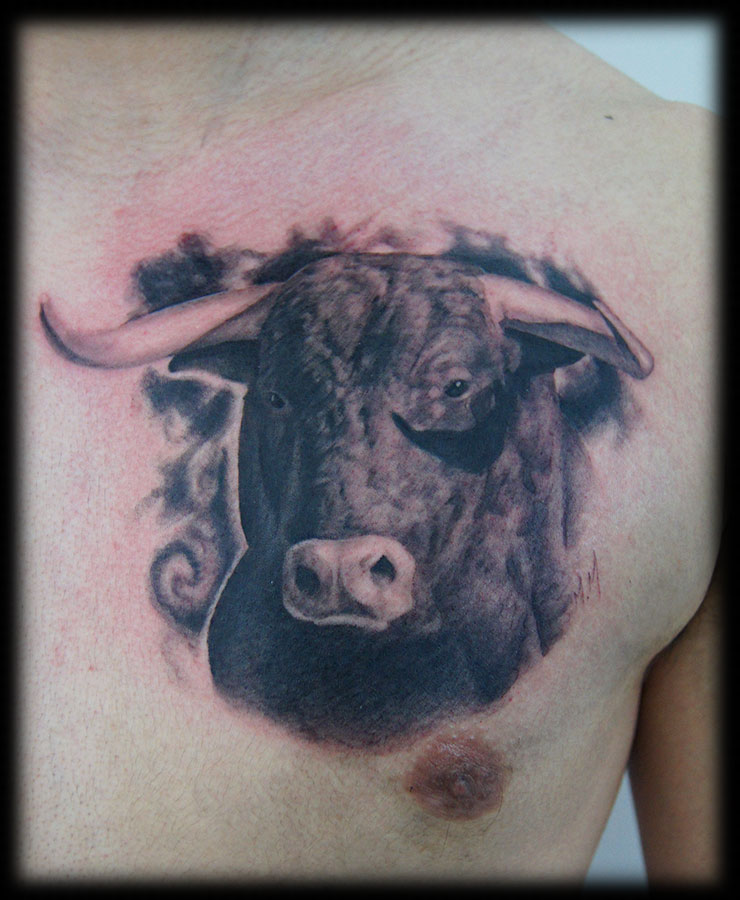 Charming Black And Red Color Ink Realism Bull Head Poitrait Tattoo On Chest For Boys