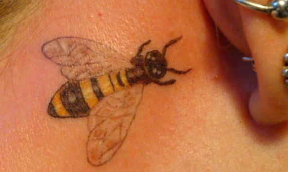 Charming Black And Yellow Color Ink Bumblebee Tattoo On Neck For Girls