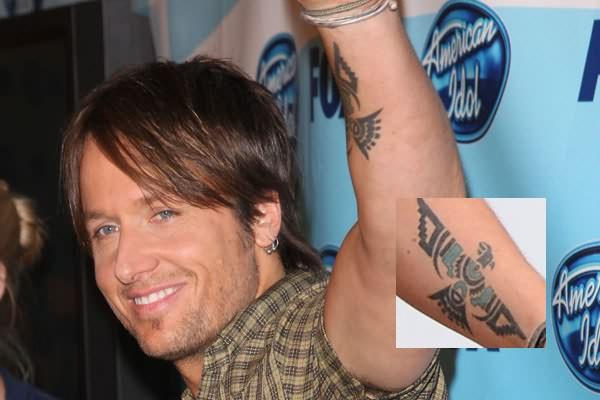 Coolest Blue And Black Color Ink Eagle Tattoo On Celebrity Arm For Boys