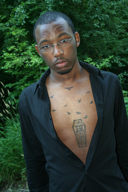 Creative Grey Color Ink Coffin Tattoo On Chest For Boys