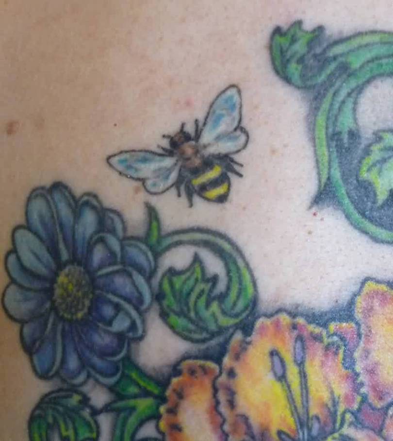 Custom Black Blue And Green Color Ink Bee & Flowers Tattoo On Back For Girls