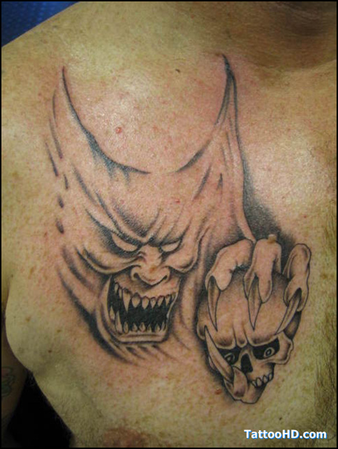 Cute Black Color Ink Demon Face Tattoo On Chest For Boys