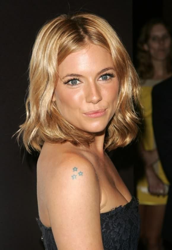 Cute Black Color Ink Star Tattoo On Celebrity Shoulder For Girls
