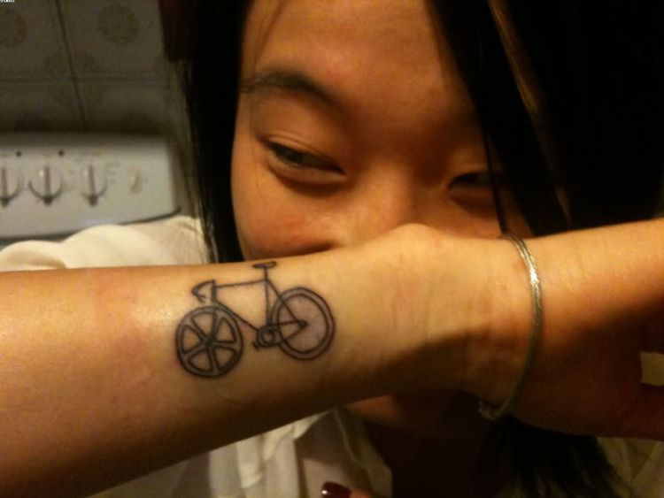 Cute Small Halk Cycle On Wrist Tattoo For Guys