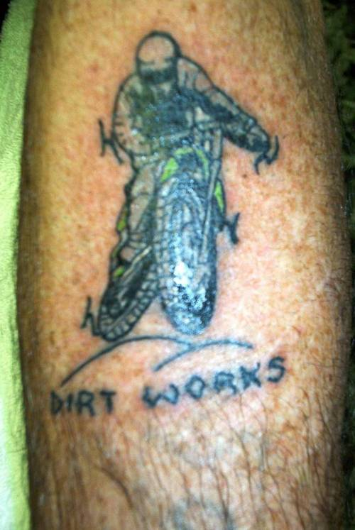 Dream Cather Green And Black Color Ink Dirt Bike Rider Tattoo Design On Arm For Boys