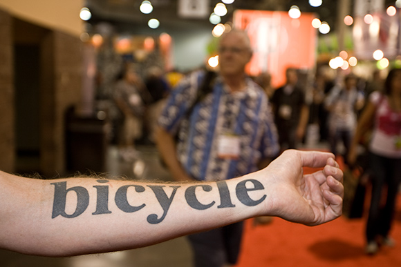 Elegant Black Color Ink Bicycle Tattoo On Arm For Boys