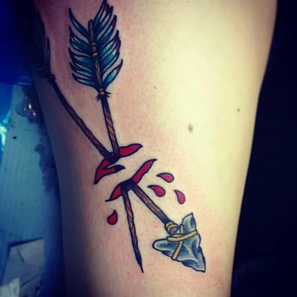 Elegant Blue Red And Grey Color Ink Ancient Arrows Ripped Skin Tattoo On Leg For Girls