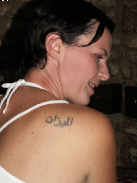 Extremely Grey Color Ink Arabic Word Tattoo On Back Shoulder For Girls